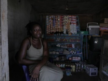 """Some women start up small businesses in the hope that they support their families. Here """"Esther"""" is in her little kiosk funded by an Italian NGO which helps repatriated African women. (Photo: Janus Metz)"""