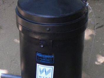 Bottles with pesticides, containing enough to last a farmer an entire season, can be placed into the pesticide container, which is made from a UV-resistant material. Only the top cover extends above the ground when the container is buried in the soil. Under the lid is another locked lid. The stick at the bottom ensures that the container cannot be pulled out of the ground once it has been buried. (Photo: Flemming Konradsen)
