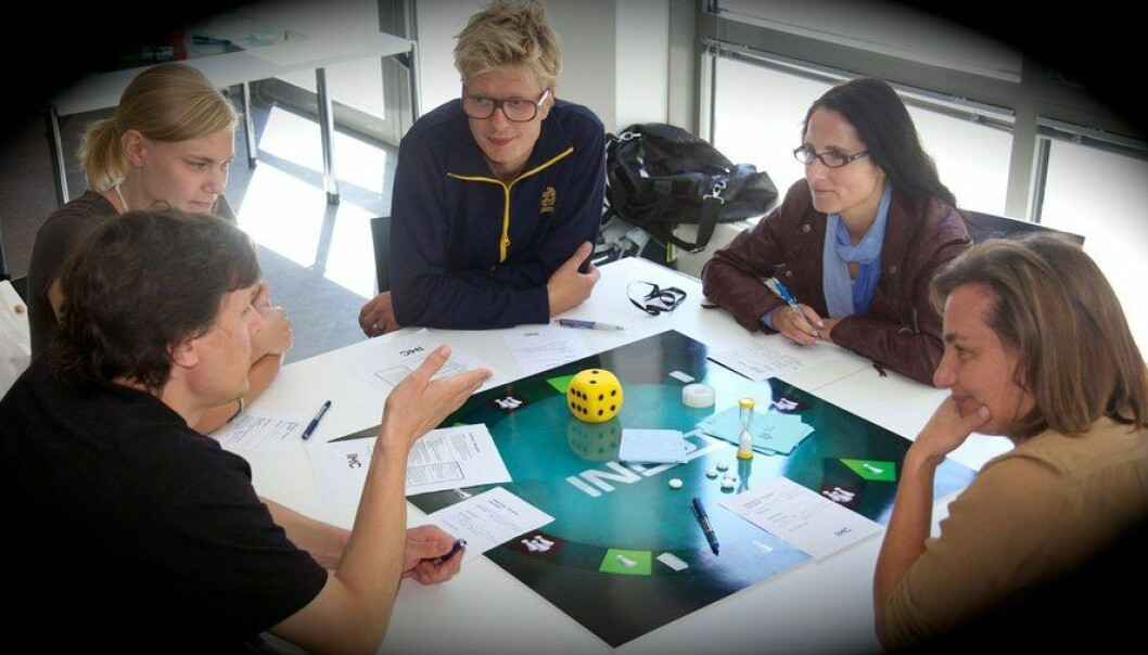It resembled a proper game, but in reality the board, cards, and pieces are entirely superfluous. Nonetheless, the players engaged whole-heartedly – and enjoyed every bit of it. (Photo: Interacting Minds Center)