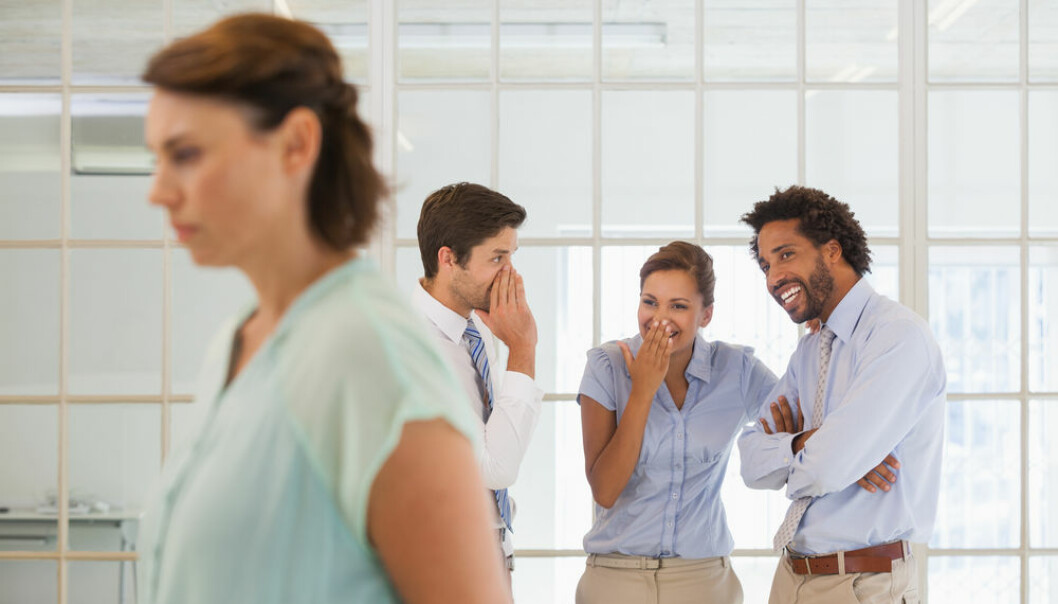 "People who feel their colleagues are bullying them face a ninefold risk of developing a depression, shows new study. (Photo: <a href=""http://www.shutterstock.com/da/pic-187372910/stock-photo-colleagues-gossiping-with-sad-young-businesswoman-in-foreground-at-a-bright-office.html?src=&ws=1"" target=""_blank"">Shutterstock</a>)"