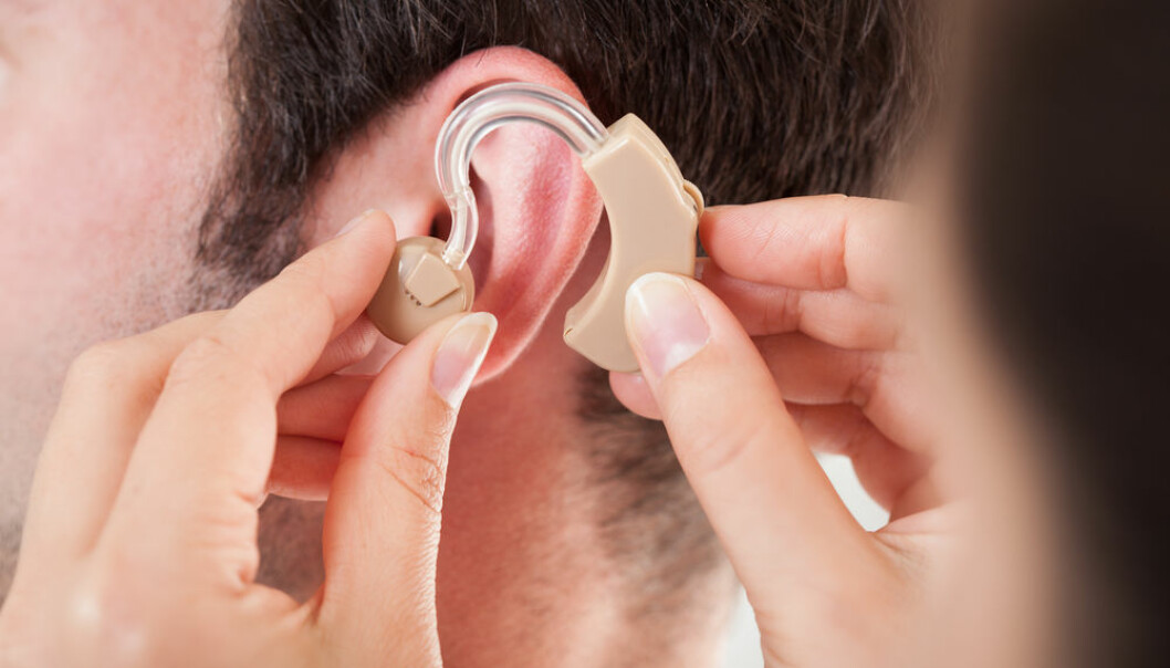 "Hearing aids have an annoying problem: acoustic feedback that sounds like howling in the ears. Scientists at DTU are working on a solution. (Photo: <a href=""http://www.shutterstock.com/da/pic-161967113/stock-photo-close-up-of-hand-helping-young-man-to-wear-hearing-aid.html"" target=""blank_"">Shutterstock</a>)"