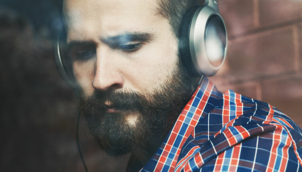 "Your choice of music during times of strife says a lot about how you process negative emotions and it may even be linked to anxiety and neuroticism, says new research. (Photo: <a href=http://www.shutterstock.com/da/pic-331764560/stock-photo-stylish-bearded-man-in-headphones-listening-to-music-near-window-with-reflection.html target=""blank_"">Shutterstock</a>)"