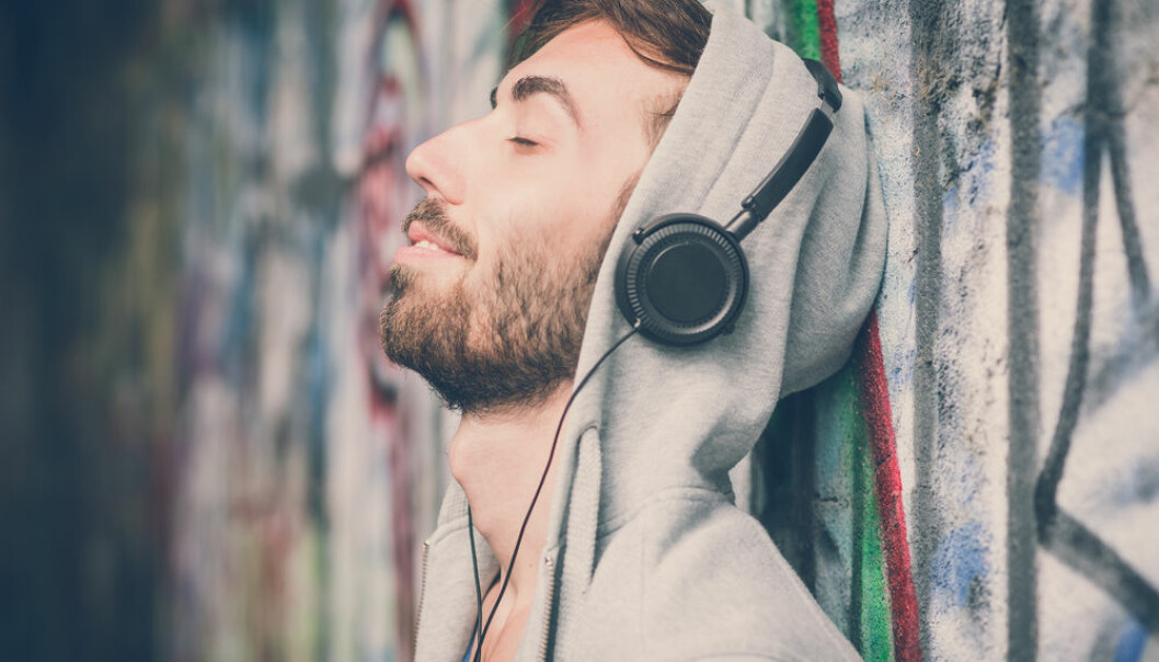 "Listening to music is a powerful way to regulate emotions. Now scientists hope to capture this mathematically to help us find the perfect track to suit our mood (Photo: <a href=http://www.shutterstock.com/da/pic-249726484/stock-photo-young-hipster-gay-man-listening-music-headphones.html target=""blank_"">Shutterstock</a>)"