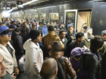 Refugees and immigrants waiting for a train to Copenhagen at the Flensburg, Germany train station on 12 November.  But their goal is Sweden, not Denmark. (Photo: Carsten Rehder / DPA / NTB)