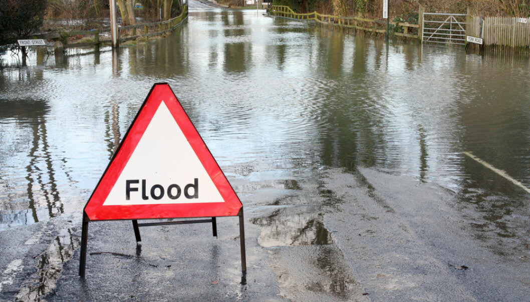"""A new computer model will monitor Denmark's water cycle--from the rain that falls on land to the groundwater stored under the earth. The new model will help local weather forecasters to predict where and when the next flood will strike. (Photo: <a href=http://www.shutterstock.com/da/pic-122886430/stock-photo-road-closed-because-of-flooding.html target=""""blank_"""">Shutterstock</a>)"""