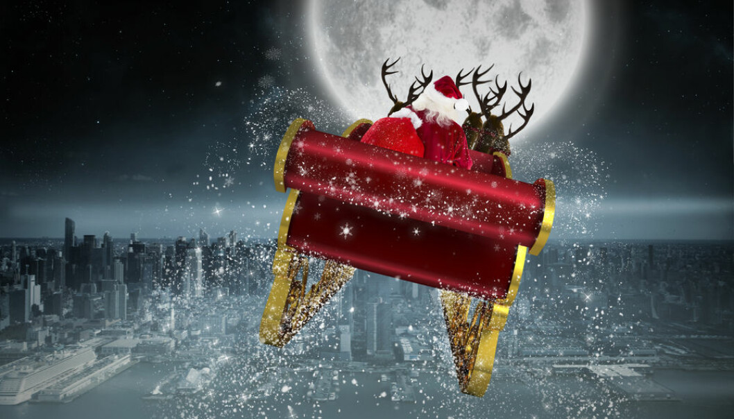 """Christmas is here! But what does science have to say about this festive time of year? (Illustration: <a href=http://www.shutterstock.com/da/pic-224694625/stock-photo-santa-flying-his-sleigh-against-balcony-overlooking-city.html target=""""blank_"""">Shutterstock</a>)"""