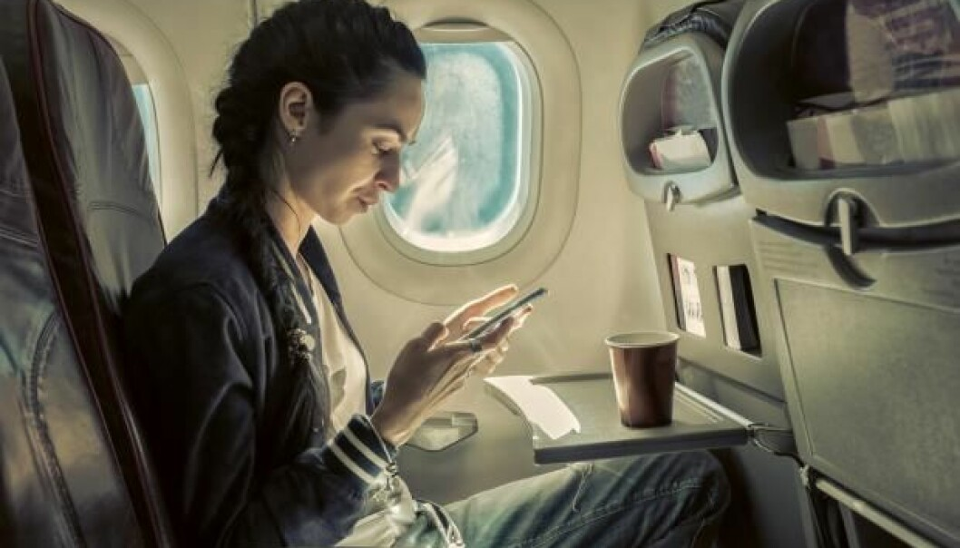 """New report suggests that high ozone combined with low humidity may be behind the common health problems reported by cabin crew and pilots. (Photo: <a href=http://www.shutterstock.com/da/pic-360102605/stock-photo-woman-sitting-at-airplane-and-looking-to-mobil-phone.html target=""""blank_"""">Shutterstock</a>)"""
