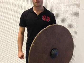 Warming with his reconstruction of a Viking round shield. (Photo: Johanne Kusnitzoff)