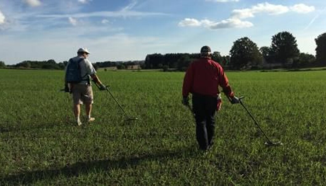 Amateur archaeologists, Ole Harpøth (left) and Freddy Arnsten (right) on the hunt in North Zealand, Denmark. (Photo: Mikkel Andreas Beck)