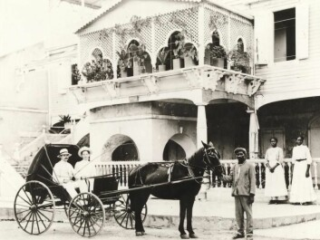 Doctor ZWergius with his wife outside their house in Frederiksted on the island of St. Croix in the Caribbean. Also pictured are their driver, Jo, and two maids, Lauretta and Elin. (Photo: Holger Knudsen, M/S Maritime Museum)