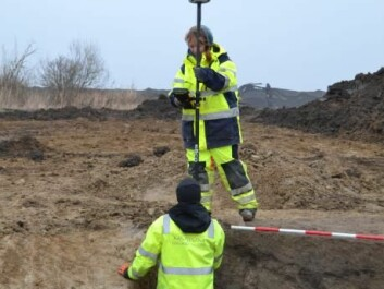 Archaeologists from Museum Lolland-Falster measure the well in which the grape seed was discovered. (Photo: Steen Knudsen, Museum Lolland-Falster)