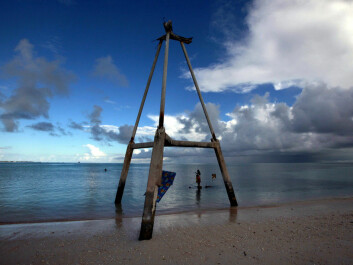 This wood tower on Bikeman islet, in the central Pacific island nation of Kiribati, used to be on the sand. Now it's in the water. Further out, locals fish. (Photo: David Gray/Reuters)