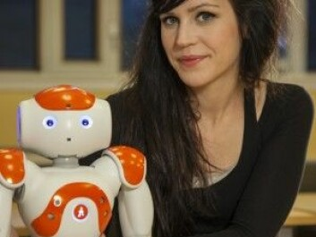 At the University of Gothenburg, Nao the robot has tried out being an educator. He is shown with researcher Sofia Serholt. (Photo: University of Gothenburg)
