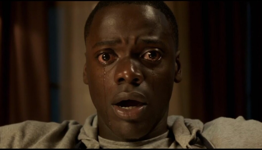 When we watch a horror film, we respond to the dangerous and horrifying situations that are being depicted. We identify with the fictional characters who confront terrifying threats. (Photo: Screen capture from the trailer for horror film 'Get Out')