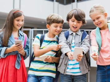 Where breaktime is taken over by smartphones and tablets, children lose the experience of playing outdoors. (Photo: Shutterstock)