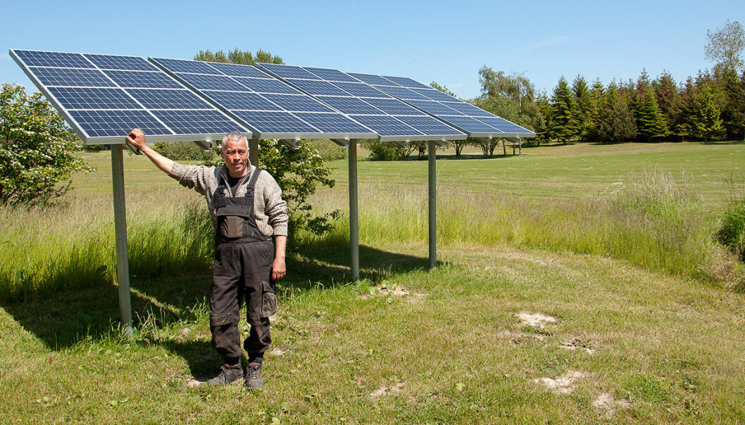 A farmer on the Danish island of Samsø with his solar panels. Samsø is home to a small community of less than 4,000 citizens who managed to switch from fossil fuels to 100 per cent renewable electricity and heat within ten years. (Photo: Samsoe Energy Academy)