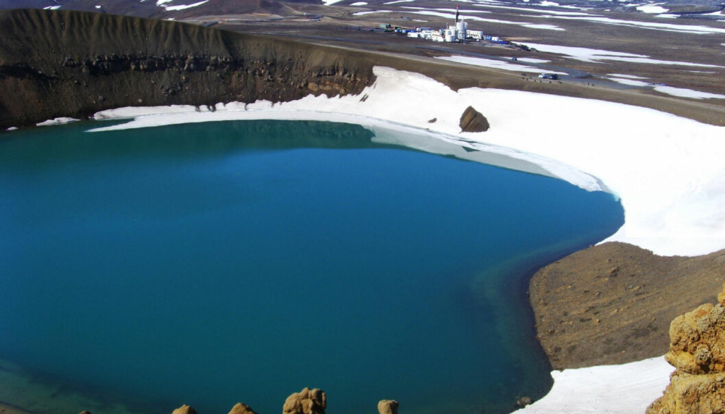 The Tyr Rig, seen in the background, drilled the hole at so IDDP-1 near the edge of the crater Víti, which is now inundated with water.  Víti means Hell in Icelandic. (Photo: IDDP)