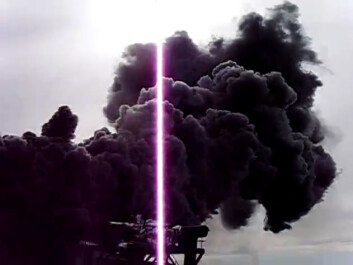 Measuring the heat flow from IDDP-1 at Krafla. The steam is black because it loosens compounds of iron, sulphur and oxygen from corroded parts of the drill string. (Photo: From a video made by IDDP)
