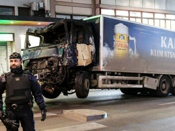 Bildetekst: The truck hijacked by the terrorist began to burn when he failed to detonate a suicide bomb. (Photo: Maja Suslin / Sweden Out / NTB scanpix)